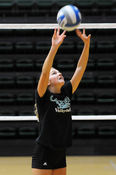 Colorado State defensive specialist Jaime Colaizzi sets the ball during practice Wednesday, Aug. 15, 2012 at Moby Arena.