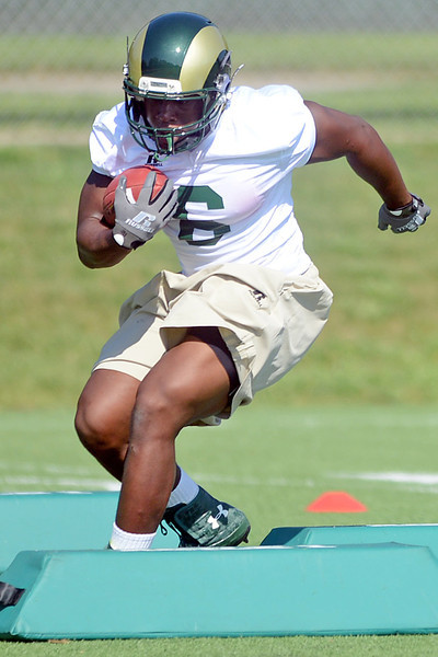 Colorado State running back Chris Nwoke works on a drill recently at the team's on-campus practice field in Fort Collins.