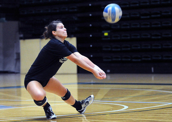 Colorado State defensive specialist Izzy Gaulia bumps the ball while participating in a drill during practice on Wednesday, Aug. 15, 2012 at Moby Arena.