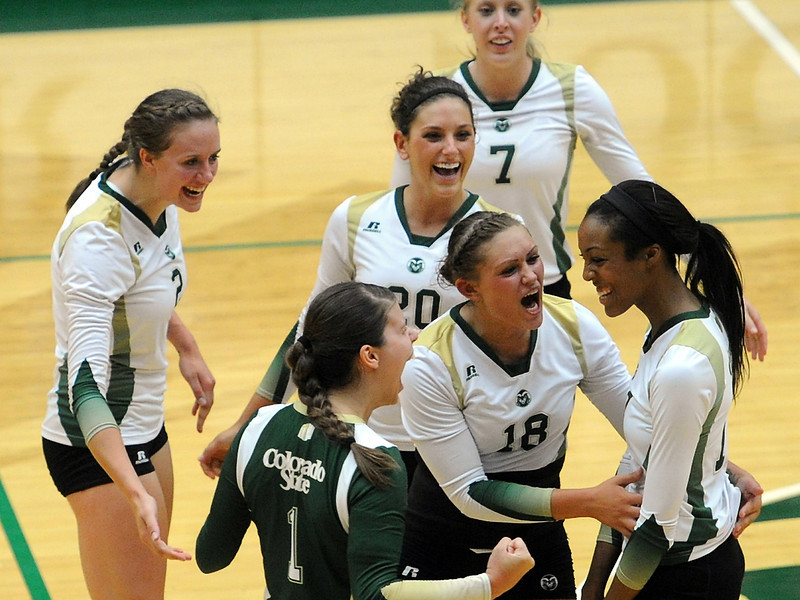 Colorado State volleyball team members celebrate after winning a point during set two of a match against Virginia on Friday, Aug. 24, 2012 at Moby Arena. The Rams won the match, 3-0.