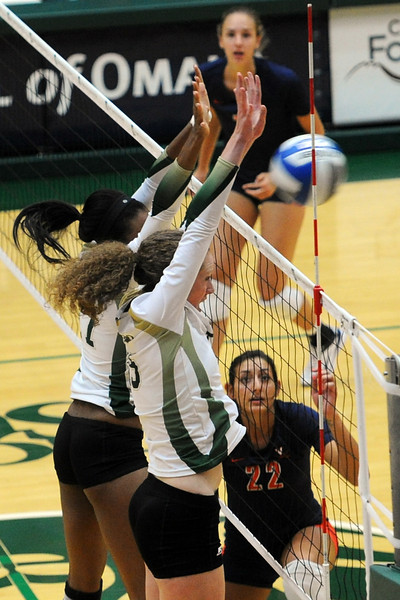 Marlee Reynolds, front, and teammate Brieon Paige go up for a block in game one of their match against Virginia on Friday, Aug. 24, 2012 at Moby Arena.