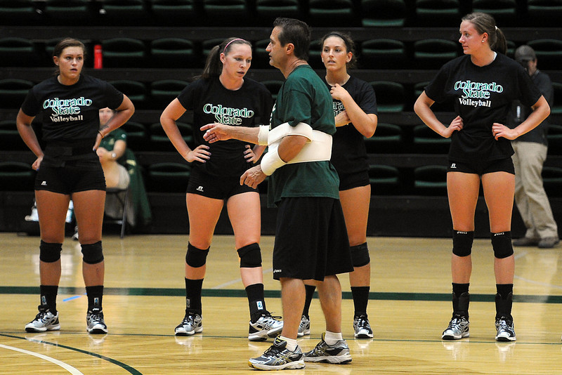 Colorado State head volleyball coach Tom Hilbert, middle, talks to players during practice on Wednesday, Aug. 8, 2012 at Moby Arena.