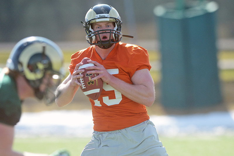 Colorado State University quarterback Connor Smith (15) works on a drill during football practice Wednesday, March 27, 2013 on-campus in Fort Collins, Colo.