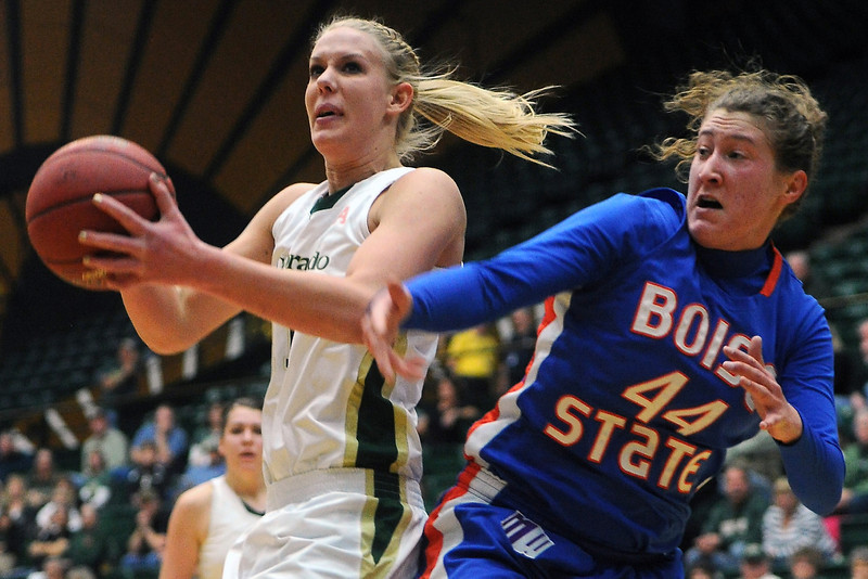 Colorado State University senior Meghan Heimstra, left, works in the lane against Boise State's Lauren Lenhardt in the first half of their game on Saturday, March 2, 2013 at Moby Arena.