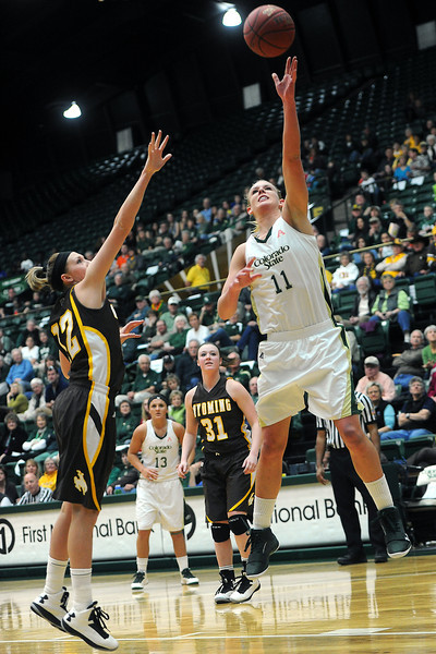 Colorado State University senior Meghan Heimstra (11) puts up a shot over Wyoming's Fallon Lewis in the first half of their game Wednesday, March 6, 2013 at Moby Arena. Heimstra led all scorers with 32 points in the Rams' defeat, 65-51.