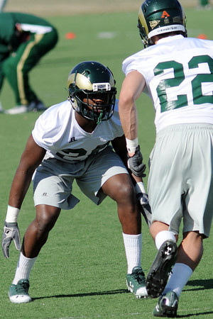 Colorado State University defensive back Kevin Pierre-Louis, left, lines up against Nick Januska while working on a drill during football practice Wednesday, March 27, 2013 on-campus in Fort Collins, Colo.