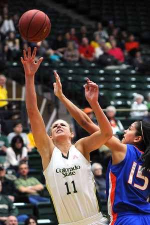 Colorado State University senior Meghan Heimstra, left, puts up a shot over Boise State's Lexie Der in the second half of their game on Saturday, March 2, 2013 at Moby Arena.