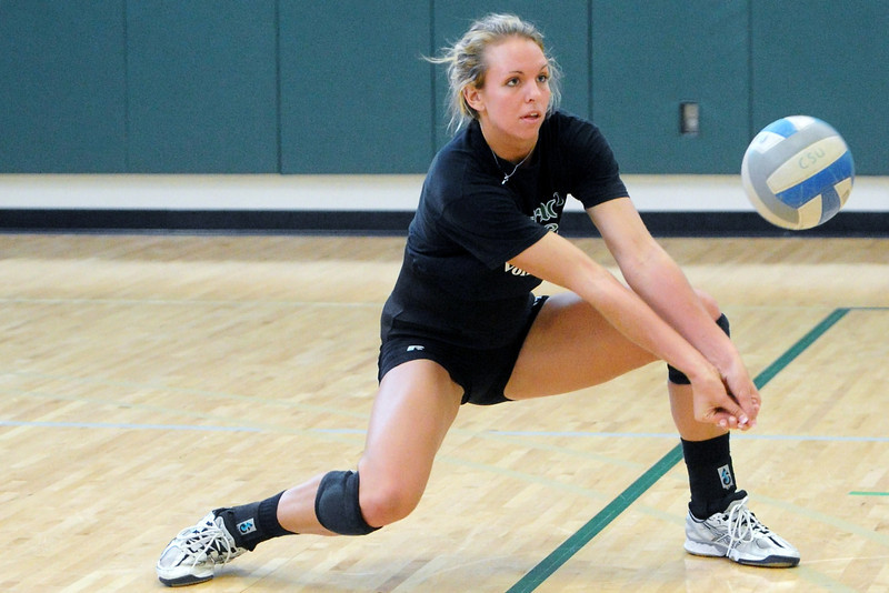 Colorado State University volleyball player Sam Peters returns a ball while participating in a drill during practice on Wednesday, March 13, 2013 at the Indoor Practice Facility on campus.