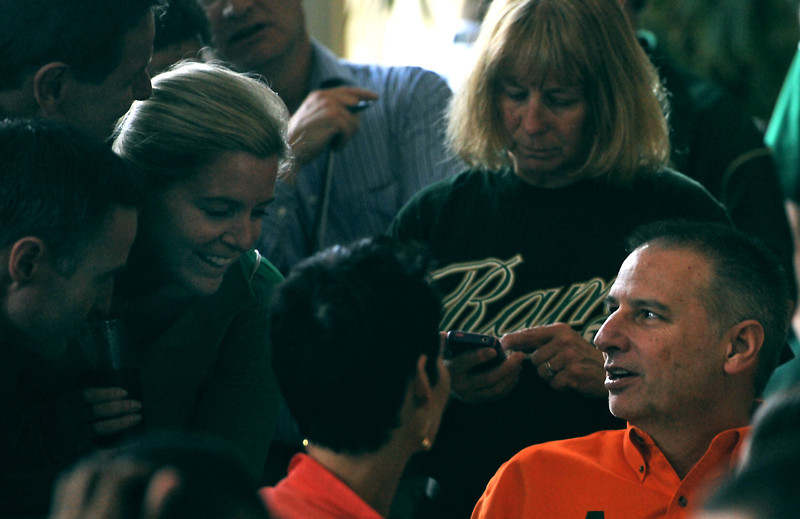 CSU Men's Basketball head coach Larry Eustachy, right, talks with CSU supporters after the announcement that CSU will enter the NCAA Tournament as an eight seed, Sunday at The Rio Grande restaurant in Ft. Collins, Colo.