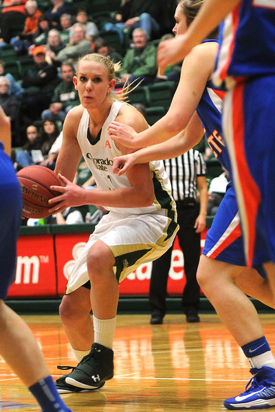 Colorado State University senior Meghan Heimstra, left, drives to the basket around Boise State's Miquelle Askew in the first half of their game on Saturday, March 2, 2013 at Moby Arena.