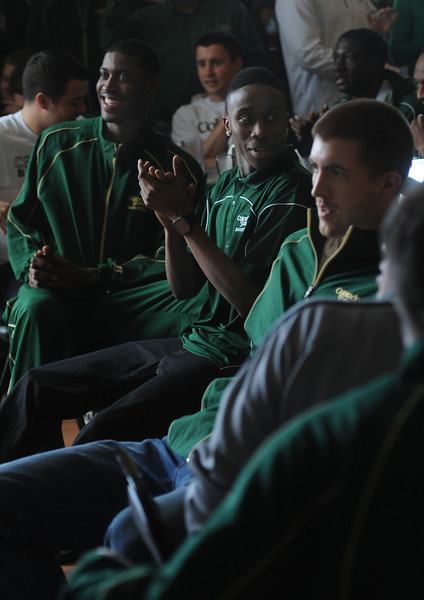 From left, CSU Men's Basketball players Jordan Mason, Jon Octeus, and Pierce Hornung react to the news of being the eighth seed in the NCAA Tournament Sunday at The Rio Grande restaurant in Ft. Collins, Colo.