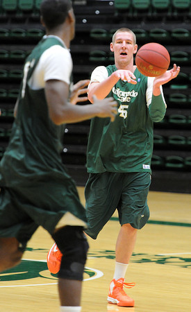 Colorado State Univeristy basketball player Colton Iverson passes the ball during practice at CSU in Fort Collins on Monday, March 18, 2013.