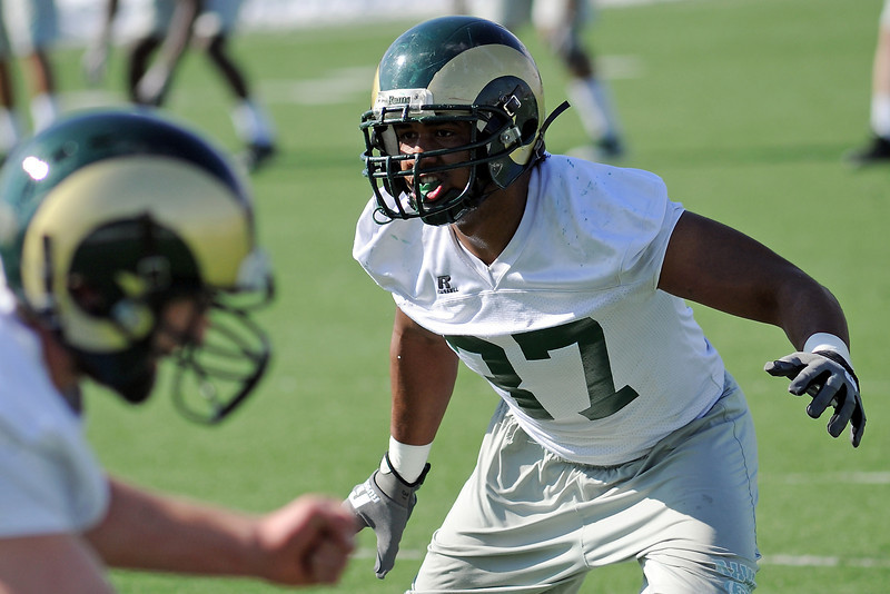 Colorado State University linebacker Aaron Davis works on a drill during football practice Wednesday, March 27, 2013 on-campus in Fort Collins, Colo.