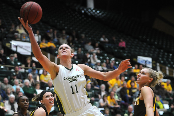 Colorado State University senior Meghan Heimstra (11) goes up for a shot between Wyoming defenders Chelan Landry, back from left, and Fallon Lewis and Kayla Woodward, right, in the second half of their game Wednesday, March 6, 2013 at Moby Arena. Heimstra led all scorers with 32 points in the Rams' 65-51 loss to the Cowgirls.