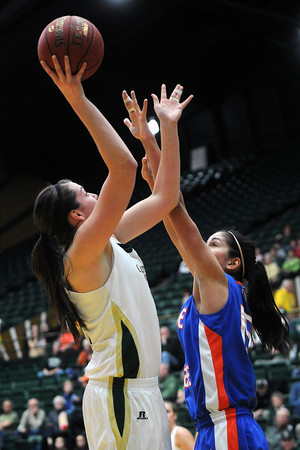 Colorado State University junior Sam Martin, left, puts up a shot over Boise State's Lexie Der in the first half of their game on Saturday, March 2, 2013 at Moby Arena.