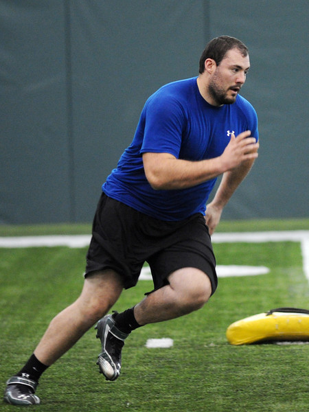 Colorado State University's Joe Caprioglio works on a drill during football pro day on Wednesday, March 13, 2013 at the Indoor Practice Facility on campus in Fort Collins, Colo.
