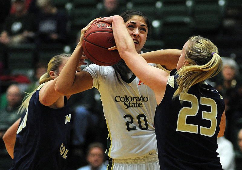 Kara Spotton of Colorado State University battles with Lauren Oosdyke, left, and Kim Lockridge of the University of Northern Colorado during the first half of Tuesday night's game at Moby Sports Arena in Fort Collins.