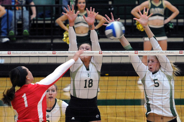 Colorado State's Megan Plourde (5) and Deedra Foss (18) go up to block a spike attempt by New Mexico's Alijah Hunsaulus during set two of their match Friday, Nov. 23, 2012 at Moby Arena.