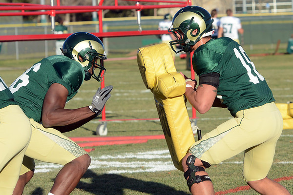 Colorado State tight ends Kivon Cartwright, left, and Crockett Gillmore work on a blocking drill during practice Tuesday at the team's on-campus practice field in Fort Collins.