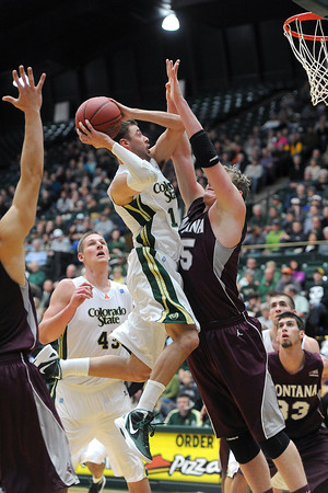 Colorado State senior Wes Eikmeier, middle, attempts a shot over Montana's Eric Hutchison in the first half of their game Friday, Nov. 9, 2012 at Moby Arena.