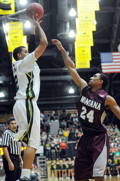 Colorado State sophomore Daniel Bejarano, left, puts up a shot over Montana's Spencer Coleman in the first half of their game Friday, Nov. 9, 2012 at Moby Arena.