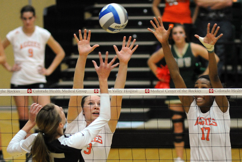 Colorado State's Adrianna Culbert (3) and Brieon Paige (17) go up for a block against UNLV's Madeline Westman during set one of their match Thursday, Nov. 8, 2012 at Moby Arena.