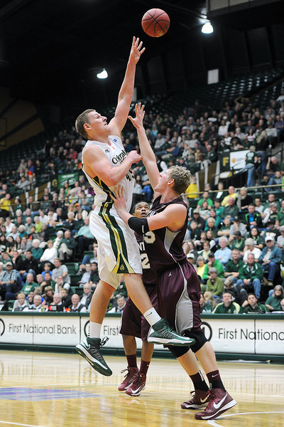 Colorado State senior Colton Iverson, left, goes up in the lane over Montana defender Eric Hutchison in the first half of their game Friday, Nov. 9, 2012 at Moby Arena.