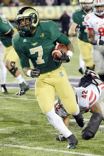 Colorado State running back Donnell Alexander (7) eludes UNLV linebacker Ken Hulbert on his way to the end zone for a touchdown in the second quarter of their game on Saturday, Nov. 10, 2012 at Hughes Stadium.