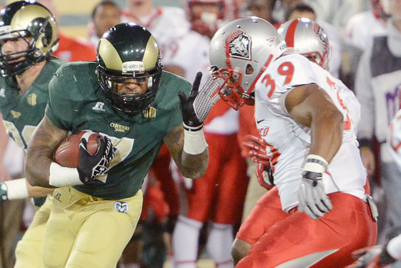 Colorado State running back Donnell Alexander, left, attempts to elude New Mexico linebacker Joe Stoner (39) on a carry in the first quarter of their game on Saturday, Nov. 24, 2012 at Hughes Stadium.