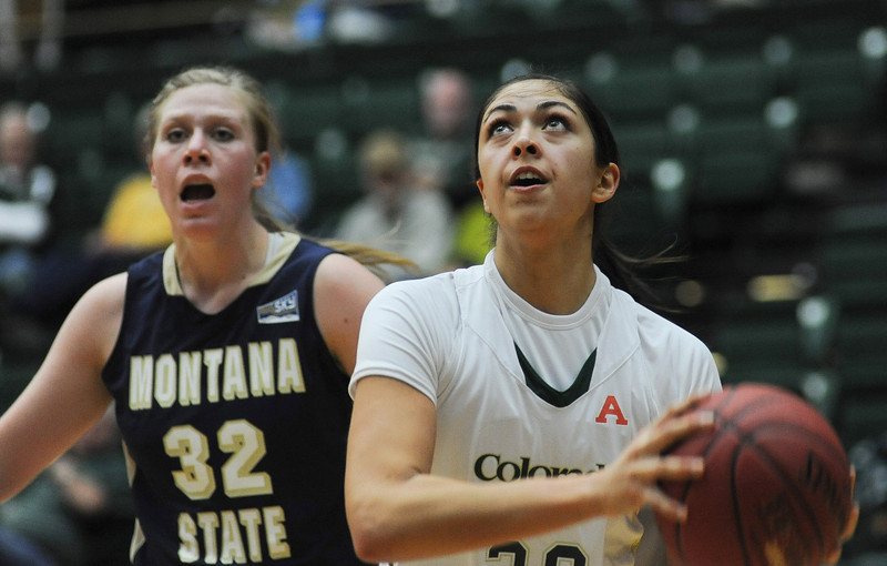 Kara Spotton, right, of Colorado State University drives past Montana State University's Rachel Semansky during the first half of Sunday afternoon's game at Moby Sports Arena in Fort Collins.