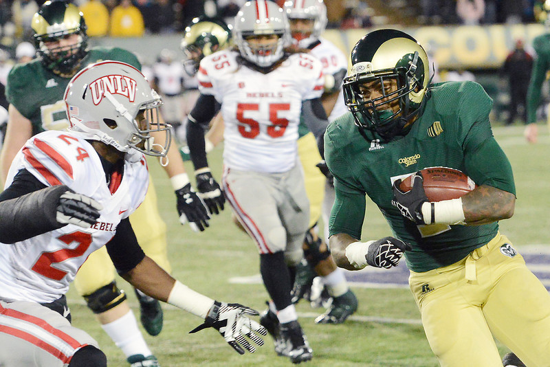 Colorado State running back Donnell Alexander, right, runs around UNLV defender Fred Wilson on his way to the end zone for a touchdown in the second quarter of their game on Saturday, Nov. 10, 2012 at Hughes Stadium.