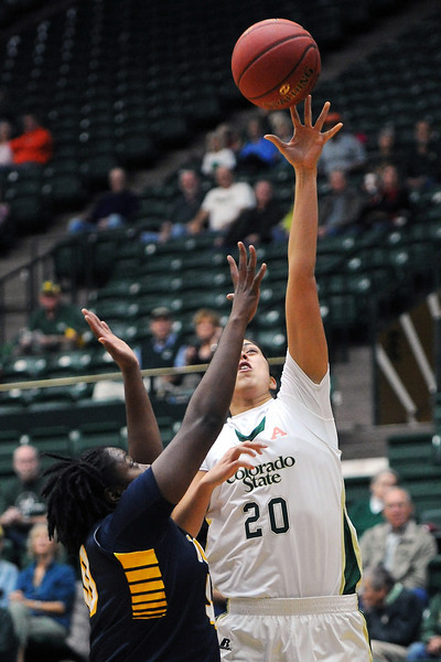 Colorado State sophomore Kara Spotton (20) puts up a shot over Toledo's Brianna Jones in the first half of their game on Tuesday, Nov. 20, 2012 at Moby Arena.