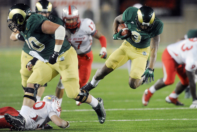 Colorado State wide receiver Marquise Law, right, runs after a catch behind the block of lineman Weston Richburg in the second quarter of their game against New Mexico on Saturday, Nov. 24, 2012 at Hughes Stadium.