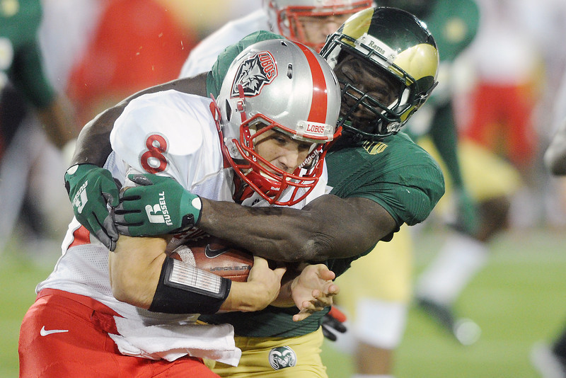 Colorado State defensive lineman Lanston Tanyi, right, tackles New Mexico quarterback Cole Gautsche (8) in the first quarter of their game on Saturday, Nov. 24, 2012 at Hughes Stadium.