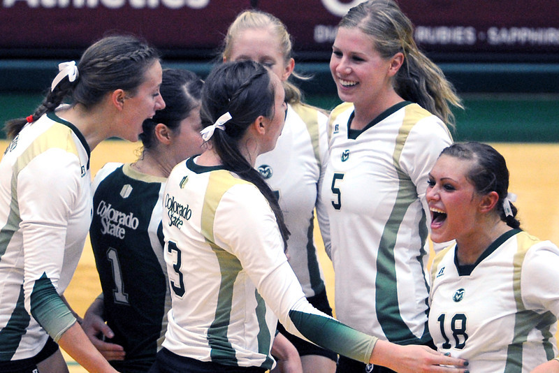 Colorado State volleyball teammates celebrate together during a match against UCLS on Sept. 15, 2012 at Moby Arena.
