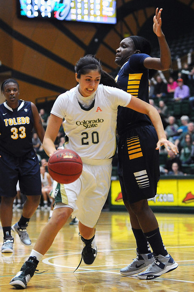 Colorado State sophomore Kara Spotton (20) drives to the basket around Toledo's Lecretia Smith in the first half of their game on Tuesday, Nov. 20, 2012 at Moby Arena.