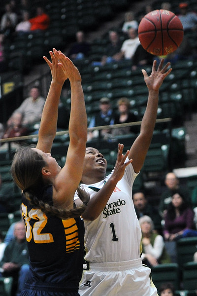 Colorado State sophomore LaDeyah Forte (1) drives to the basket around Toledo defender Ana Capotosto in the first half of their game on Tuesday, Nov. 20, 2012 at Moby Arena.