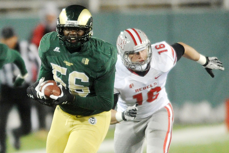 Colorado State linebacker Shaquil Barrett (56) runs away from UNLV tight end Taylor Barnhill (16) after intercepting a pass that he returned for a touchdown in the first quarter of their game on Saturday, Nov. 10, 2012 at Hughes Stadium.