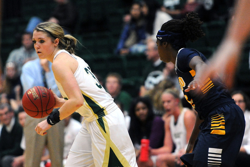 Colorado State freshman Caitlin Duffy, left, dribbles away from Toledo defender Janelle Reed-Lewis in the first half of their game on Tuesday, Nov. 20, 2012 at Moby Arena.