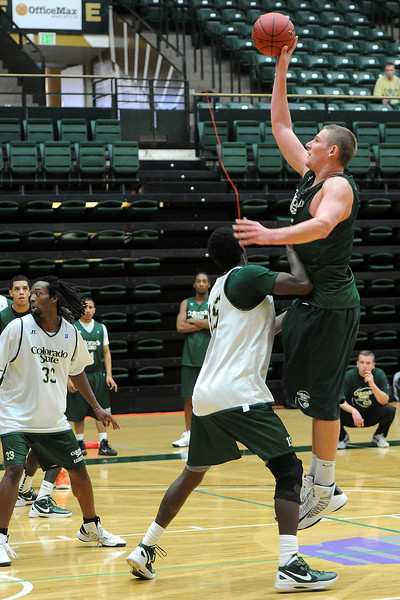 Colorado State University senior Colton Iverson, right, puts up a shot over teammate Gerson Santo during practice Tuesday, Oct. 23, 2012 at Moby Arena.