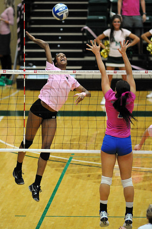 Colorado State's Brieon Paige, left, goes up for a spike during a match against Boise State on Thursday, Oct. 18, 2012 at Moby Arena.