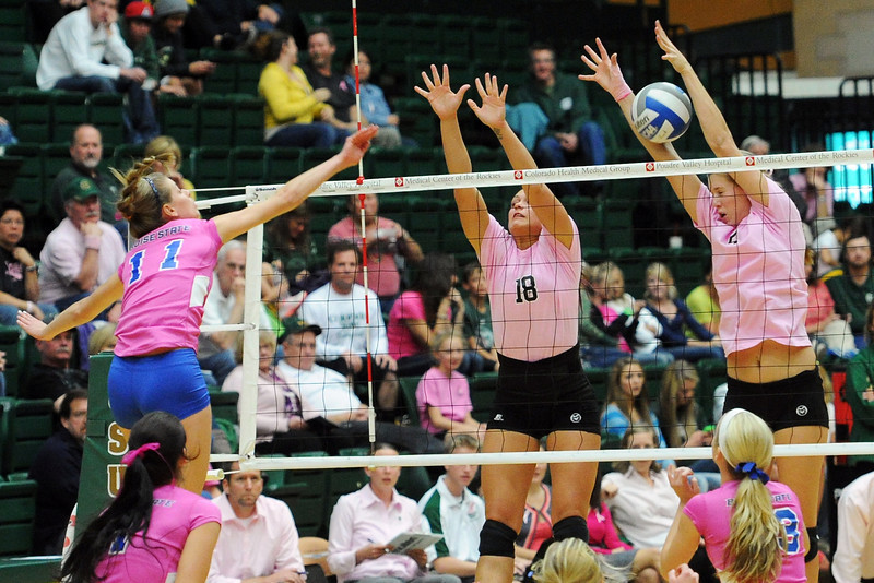 Colorado State's Megan Plourde, back right, and Deedra Foss (18) go up to block a spike by Boise State's Katelyn Kinghorn (11) during set three of their match Thursday, Oct. 18, 2012 at Moby Arena.