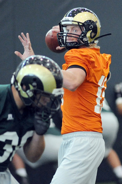 Colorado State freshman quarterback Conner Smith works on a drill during practice Tuesday, Oct. 16, 2012 at the team's on-campus practice facility.