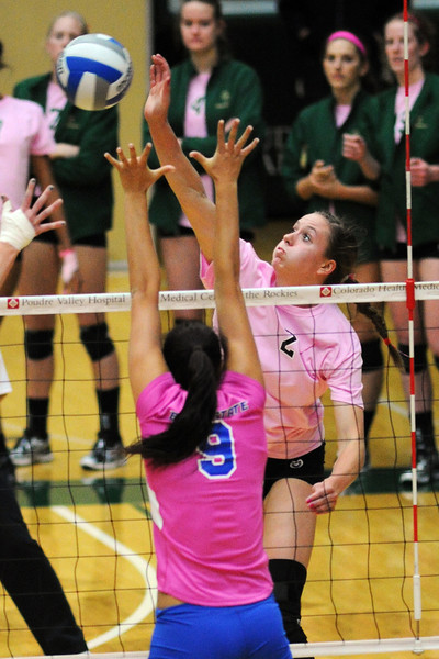 Colorado State senior Dana Cranston, right, spikes the ball past Boise State's Taylor Murphey during set two of their match Thursday, Oct. 18, 2012 at Moby Arena.