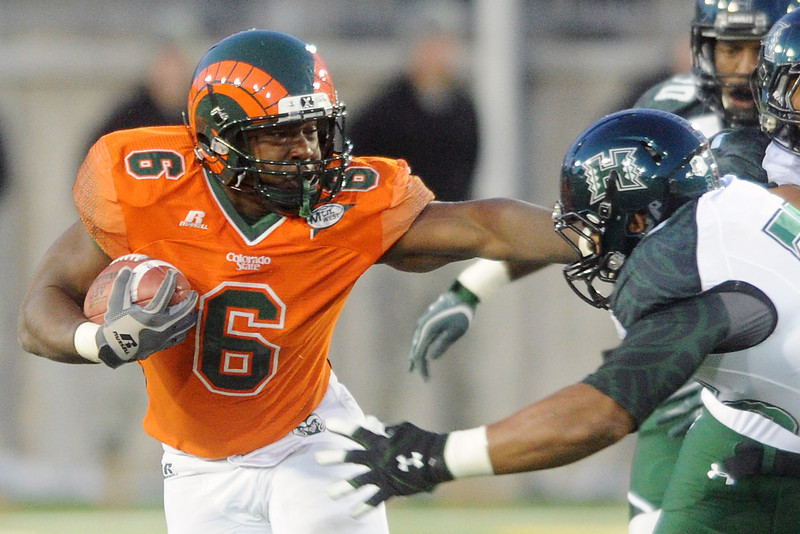 Colorado State running back Chris Nwoke rushes with the ball during a game against Hawaii on Saturday, Oct. 27, 2012 at Hughes Stadium.