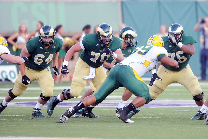 Colorado State offensive linemen Jordan Gragert (64), Weston Richburg (70) and Brandon Haynes (75) block for quarterback Garrett Grayson, back,  during their game against North Dakota State on Saturday, Sept. 8, 2012 at Hughes Stadium.