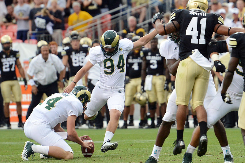 Colorado State's Jared Roberts (94) steps up to kick a field goal as teammate M.J. McPeek holds in the fourth quarter of their game against Colorado on Saturday, Sept. 1, 2012 at Sports Authority Field at Mile High.