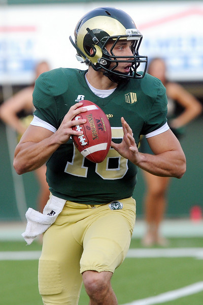 Colorado State University quarterback Garrett Grayson looks downfield in the first quarter of a game against Utah State on Saturday, Sept. 22, 2012 at Hughes Stadium in Fort Collins.