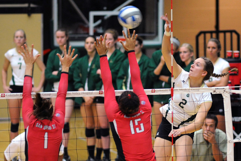 Colorado State University senior Dana Cranston (2) spikes the ball over San Diego State's Andrea Hannasch (1) and Chaiymin Steel (15) during set two of their match on Saturday, Sept. 29, 2012 at Moby Arena in Fort Collins, Colo.