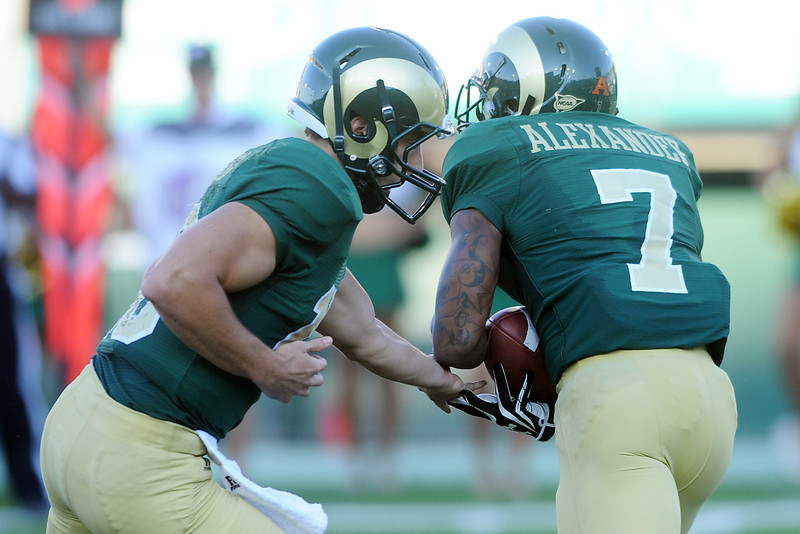 Colorado State quarterback Garrett Grayson, left, hands the ball off to running back Donnell Alexander in the second quarter of their game against North Dakota State on Saturday, Sept. 8, 2012 at Hughes Stadium.